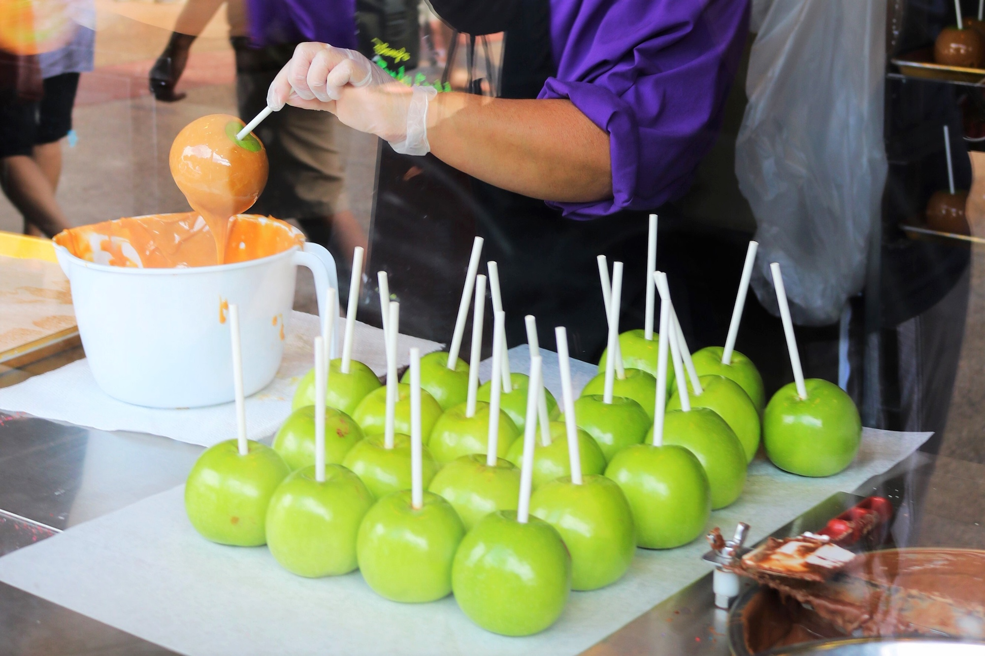 making candy apples at Disney Springs